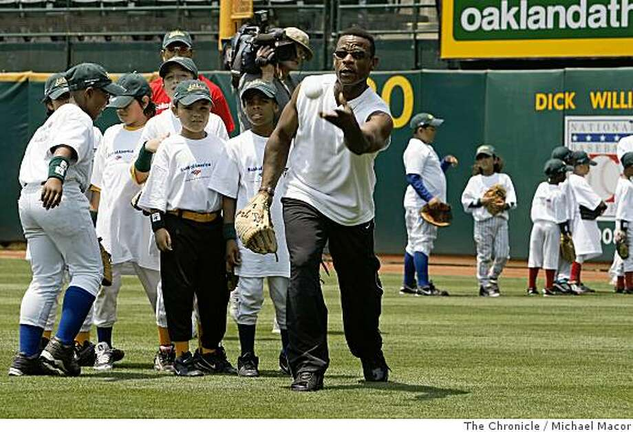 2008: Former Oakland Athletic star, Rickey Henderson, tosses pop-ups to future stars during the Bank of America Youth Baseball Clinic at the McAfee Coliseum in Oakland, Calif., on Tuesday July 8, 2008. Photo: Michael Macor, The Chronicle