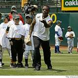 Former Oakland Athletic star, Rickey Henderson, tosses pop-ups to future stars during the Bank of America Youth Baseball Clinic at the McAfee Coliseum in Oakland, Calif., on Tiesday July 8, 2008.Photo By Michael Macor/ The Chronicle