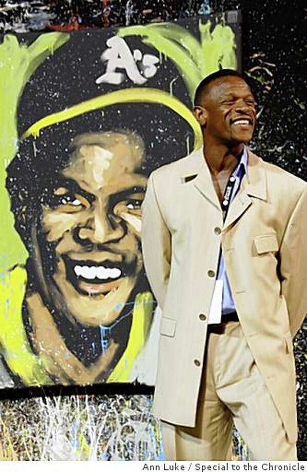 "Rickey henderson with painting by David GaribaldiThe Oakland A's Community Fund's third Annual Dinner on the Diamond at McAfee Coliseum raised more than $100,000 for the A's Community Fund and LA based camp ""The Painted Turtle"" for children with serious health issues. Photo: Ann Luke, Special To The Chronicle"