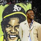 "Rickey henderson with painting by David GaribaldiThe Oakland A's Community Fund's third Annual Dinner on the Diamond at McAfee Coliseum raised more than $100,000 for the A's Community Fund and LA based camp ""The Painted Turtle"" for children with serious health issues."