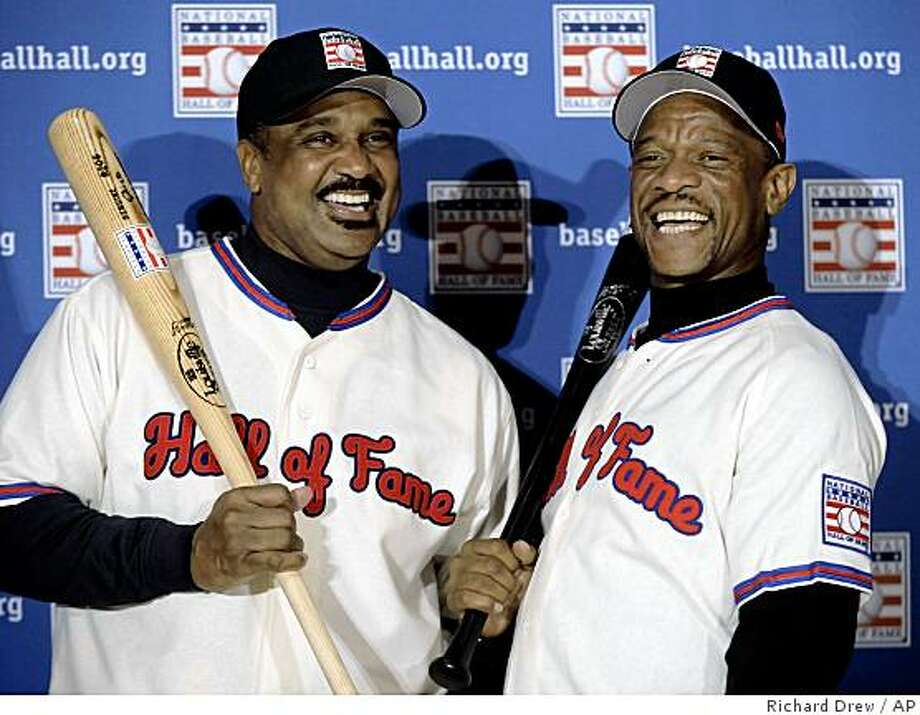 Baseball Hall of Fame inductees Jim Rice, left, and Rickey Henderson pose for photos during a New York news conference, Tuesday Jan. 13, 2009. Photo: Richard Drew, AP