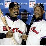 Baseball Hall of Fame inductees Jim Rice, left, and Rickey Henderson pose for photos during a New York news conference, Tuesday Jan. 13, 2009.