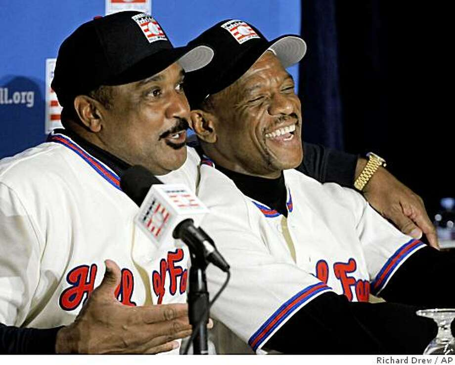 Baseball Hall of Fame inductees Jim Rice, left, and Rickey Henderson react during a New York news conference, Tuesday Jan. 13, 2009. Photo: Richard Drew, AP