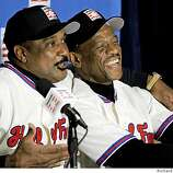 Baseball Hall of Fame inductees Jim Rice, left, and Rickey Henderson react during a New York news conference, Tuesday Jan. 13, 2009.