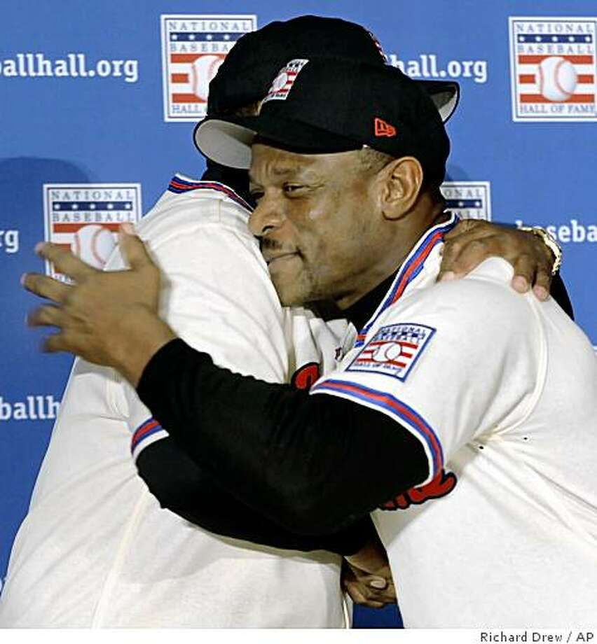 Baseball Hall of Fame inductees Jim Rice and Rickey Henderson, foreground, embrace during a New York news conference, Tuesday Jan. 13, 2009. Photo: Richard Drew, AP