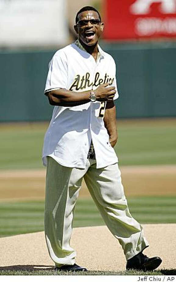Hall-of-Famer and former Oakland Athletics' Rickey Henderson laughs after throwing the ceremonial first pitch before the Athletics played the San Francisco Giants in a spring training baseball game in Phoenix, Saturday, March 14, 2009. (AP Photo/Jeff Chiu) Photo: Jeff Chiu, AP