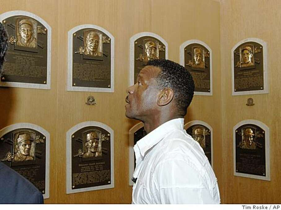 Class of 2009 Baseball Hall of Fame inductee Rickey Henderson views plaques on a tour of the National Baseball Hall of Fame and Museum in Cooperstown, N.Y., on Friday, May 8, 2009. Photo: Tim Roske, AP