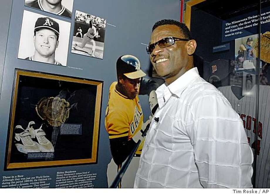 Class of 2009 Baseball Hall of Fame inductee Rickey Henderson enjoys a tour of the National Baseball Hall of Fame and Museum in Cooperstown, N.Y., on Friday, May 8, 2009.  At lower left are shoes he wore when he tied Lou Brock's stolen base record. Photo: Tim Roske, AP