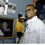 Class of 2009 Baseball Hall of Fame inductee Rickey Henderson enjoys a tour of the National Baseball Hall of Fame and Museum in Cooperstown, N.Y., on Friday, May 8, 2009.  At lower left are shoes he wore when he tied Lou Brock's stolen base record.