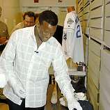 Class of 2009 Baseball Hall of Fame inductee Rickey Henderson handles objects from his career in the archives of the National Baseball Hall of Fame and Museum in Cooperstown, N.Y., on Friday, May 8, 2009.