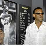 Class of 2009 Baseball Hall of Fame inductee Rickey Henderson stands near a display showing him as baseball's all-time  run scorer during a tour of the National Baseball Hall of Fame and Museum in Cooperstown, N.Y., on Friday, May 8, 2009.  The color photo at lower left is of Ken Griffey, Jr., the games current active leading scorer.
