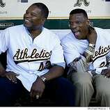Dave Henderson (left) and Rickey Henderson celebrate the 20th anniversary of the 1989 World Series before the start of the A's game against the Giants on Tuesday.