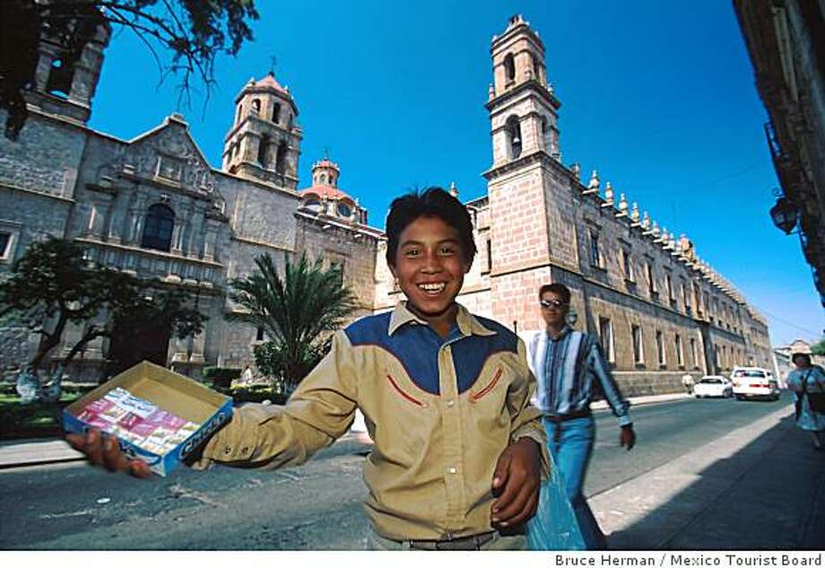 A boy sells candy on the streets of Morelia. The state capital is a candy-making center, with a market devoted to selling sweets. Photo: Bruce Herman, Mexico Tourist Board