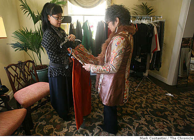 Anne Namba (left), Hawaiian fashion designer shows clothes to client Carole Hayashino during a trunk show for Namba in San Francisco Calif. on Friday, March 20, 2009. Photo: Mark Costantini, The Chronicle