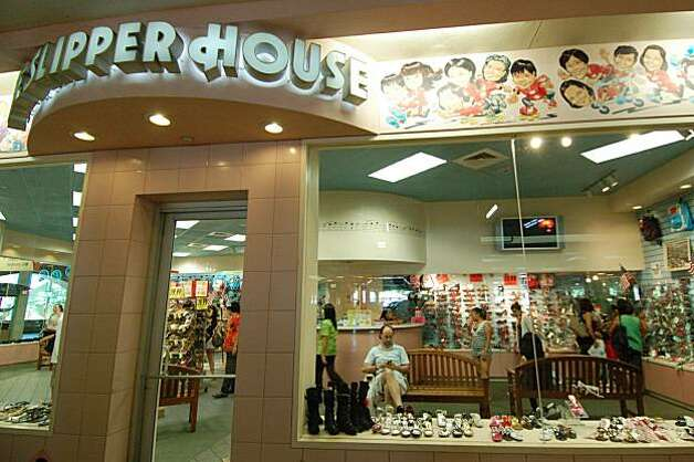 One of the original tenants of the 51-year-old Ala Moana Center, the family-owned Slipper House stocks trendy, inexpensive sandals and other casual footwear. Photo: Jeanne Cooper, Special To SFGate
