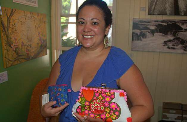 "Cory Labang, who makes purses and ""stash bags"" from vintage and retro-style fabrics, displays her wares at the Lanai Art Center and Gallery. Photo: Jeanne Cooper, Special To SFGate"