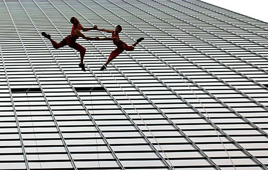 Thanksgiving Tower in Dallas: 645 feet, 50 storiesPictured: Aerial dancers from Project Bandaloop perform a dance as they rappel down the side Tuesday, Aug. 17, 2010. Photo: Cody Duty, AP