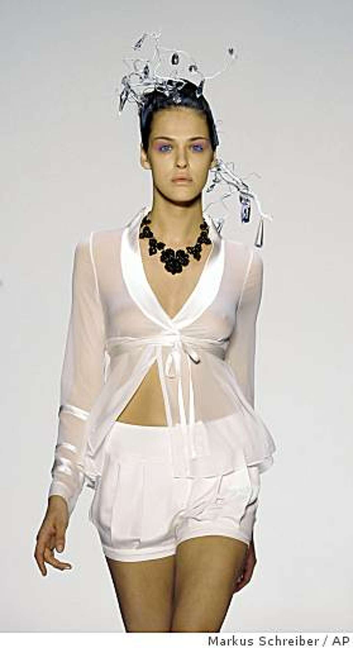** EDS NOTE NUDITY ** A model presents a creation from the spring/summer 2010 collection of fashion label Scherer Gonzalez during the Mercedes Benz Fashion Week in Berlin, Germany, Saturday, July 4, 2009. (AP Photo/Markus Schreiber) ** EDITORIAL USE ONLY **