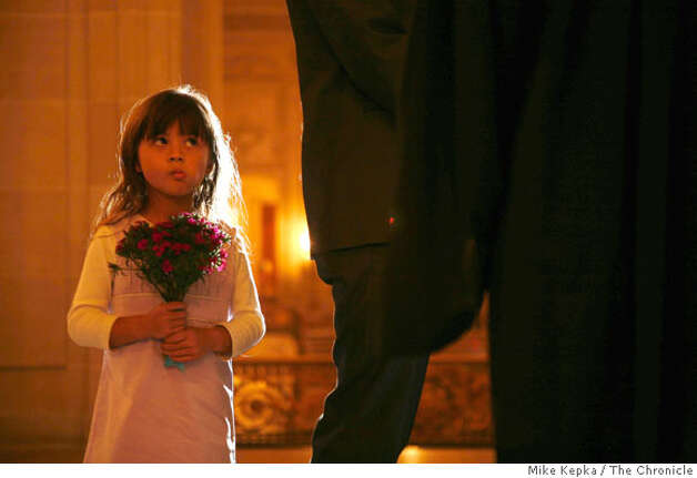 Flower girl, Elyssa Wolter, 5, of Los Gatos watches as her uncles Hy Le and Sean Nhan get married at San Francisco City Hall on Tuesday Nov. 4, 2008. Photo: Mike Kepka, The Chronicle