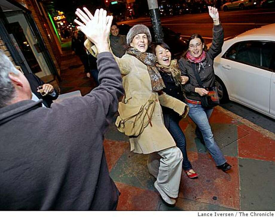 Chiropractor Milton Rennie O'Brien stands outside his office on Valencia Street in San Francisco Tuesday November 4, 2008 greeting young voters as they celebrated Barack Obama victory walking up and down Valencia San Francisco Calif. Photo: Lance Iversen, The Chronicle