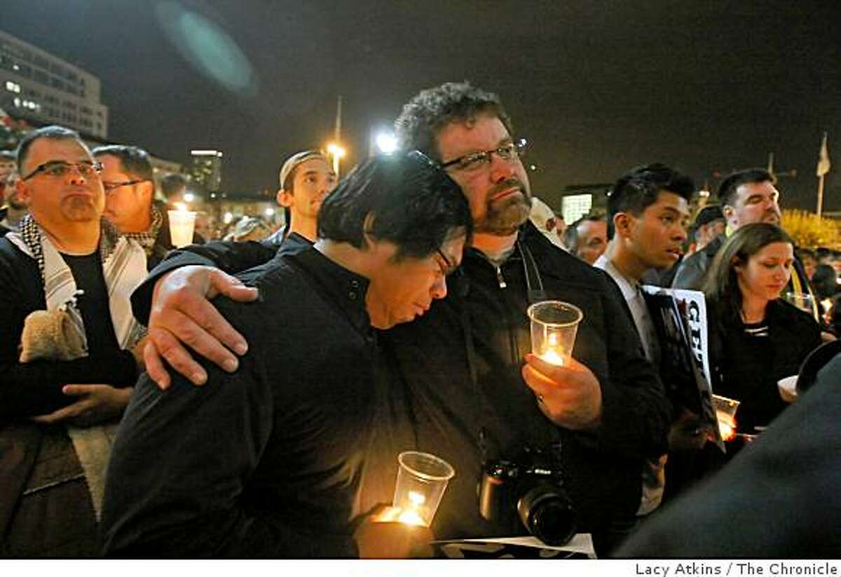 Coy Abellano is comforted by Erwin Barron as he cries outside City Hall where hundreds of people gather for a candlelight vigil in response to Proposition 8 in San Francisco, Calif., on Wednesday, Nov. 5, 2008.