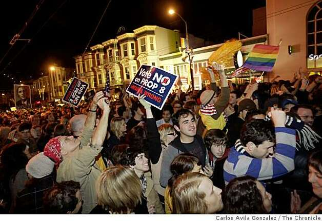 With a mixture of happiness and sadness, a crowd on Castro Street in San Francisco, Calif., celebrate the election of Barack Obama to the presidency while Proposition 8 was winning in the late hours of election night, Tuesday, November 4, 2008. Photo: Carlos Avila Gonzalez, The Chronicle