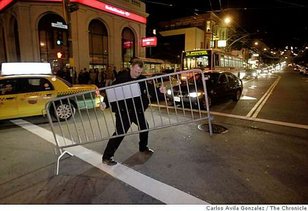 An SFPD officer barricades the intersection of 18th and Castro Streets as a celebration begins when Barack Obama won the presidency of the United States. Reaction to the election of Barack Obama to the presidency in the Castro District of San Francisco, Calif., on election night, Tuesday, November 4, 2008. Photo: Carlos Avila Gonzalez, The Chronicle
