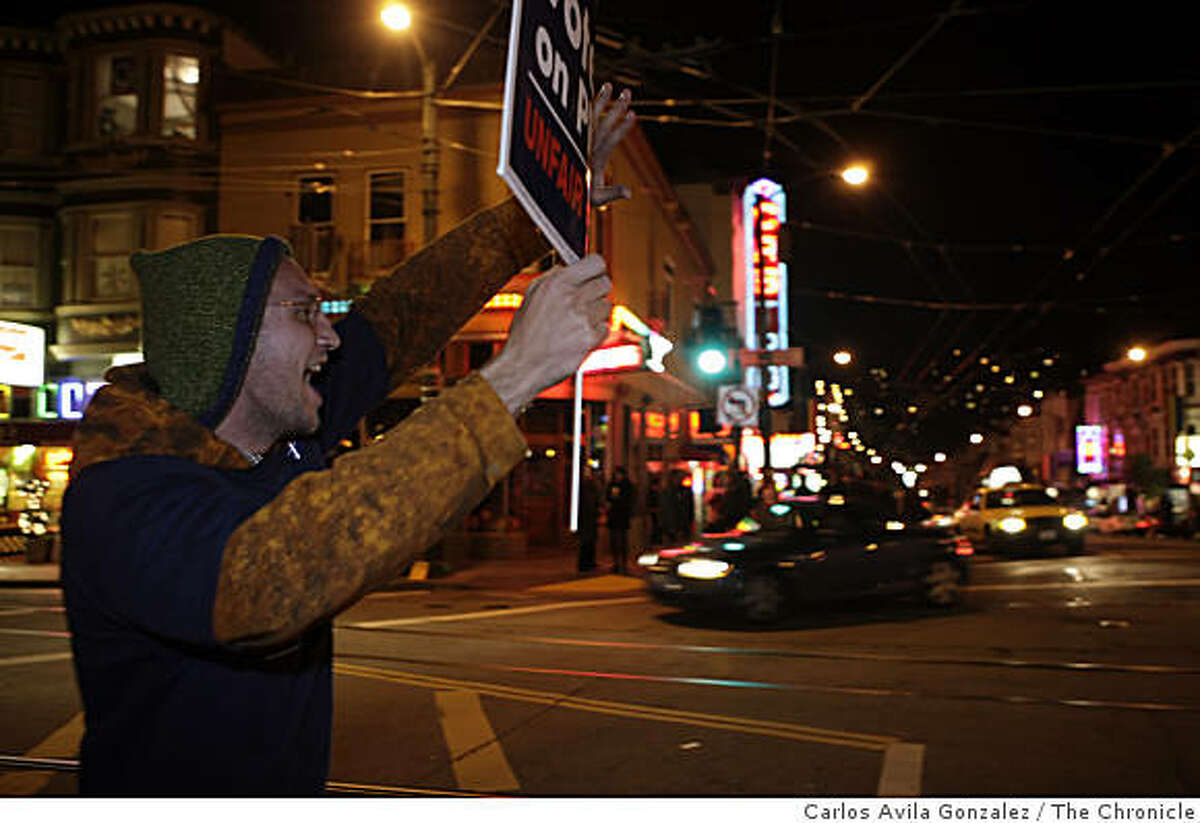 Jason Lloyd, of San Francisco, prompts drivers to honk against Proposition 8 at the intersection of Castro Street and Market Street. He had been out at the intersection for 10 hours that day. Reaction to Proposition 8 in the Castro District of San Francisco, Calif., on election night, Tuesday, November 4, 2008.