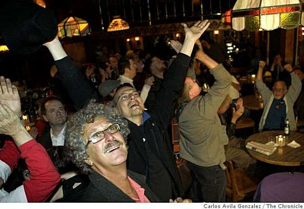 Brennan Kreller, rear, and Steve Merlo react to the announcement that Barack Obama won the presidency. Reaction to the election of Barack Obama to the presidency in the Castro District of San Francisco, Calif., on election night, Tuesday, November 4, 2008. Photo: Carlos Avila Gonzalez, The Chronicle