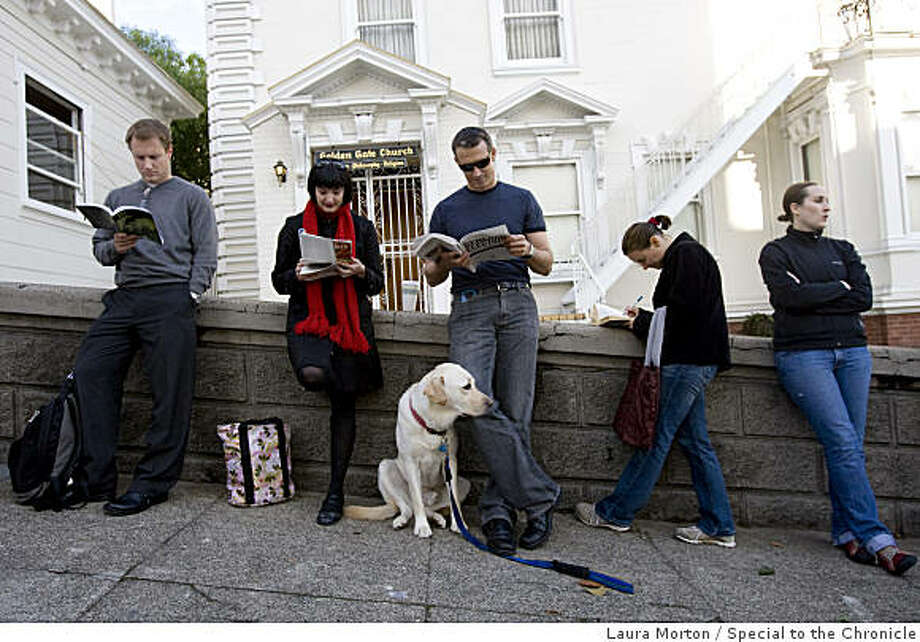 Voters, including David Adams (third from right) who brought his dog, Mackie, with him, wait in a long line outside the Golden Gate Church at Franklin and Clay Streets in San Francisco. Photo: Laura Morton, Special To The Chronicle