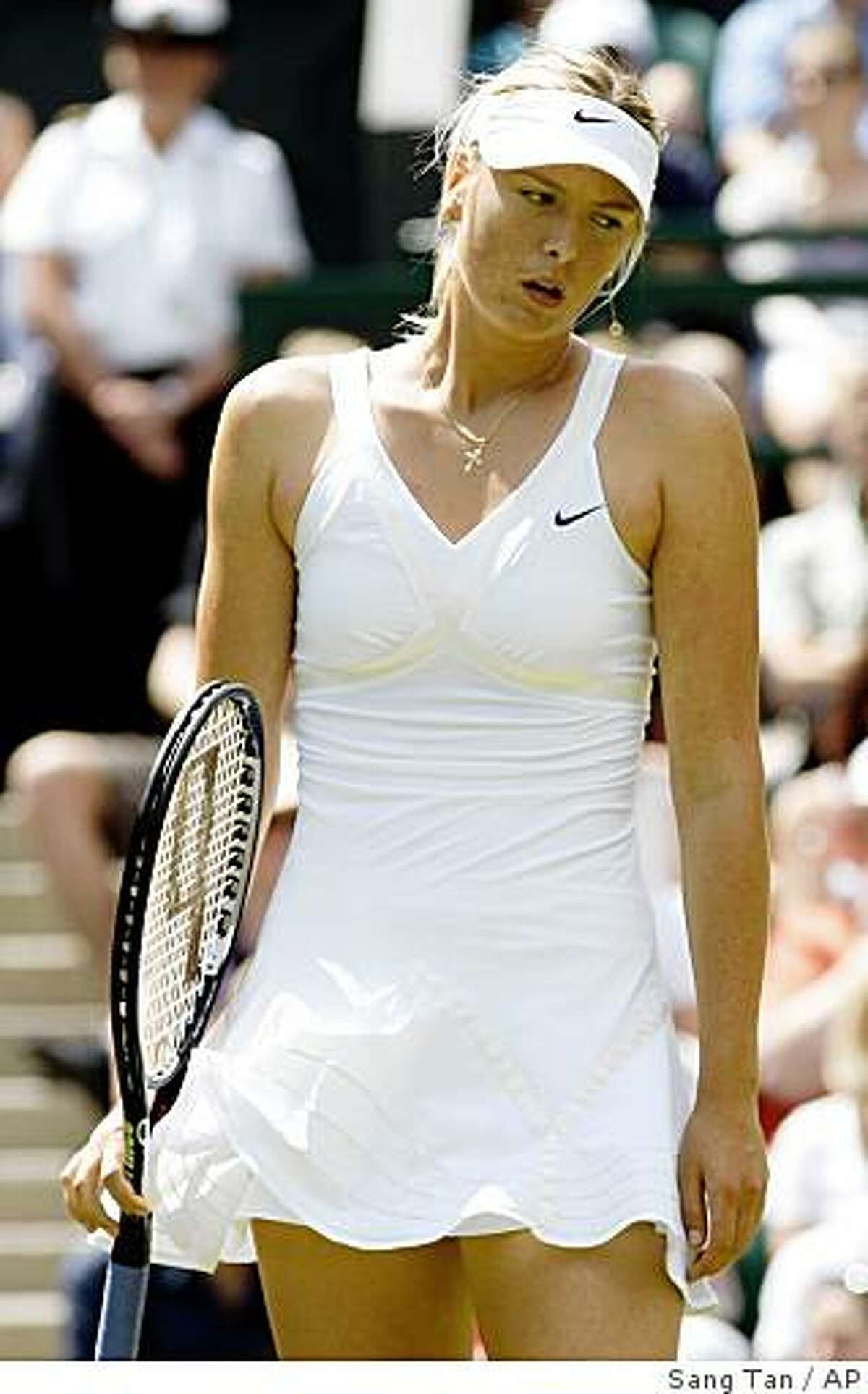 Maria Sharapova of Russia reacts during her women's singles match against Gisela Dulko of Argentina, on the Centre Court at Wimbledon, Wednesday, June 24, 2009. Dulko pulled off a surprise win over Sharapove.(AP Photo/Sang Tan)