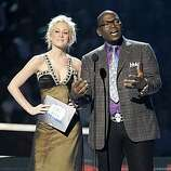 Kelly Pickler and Randy Jackson present an award at the CMT Music Awards in Nashville, Tenn. Tuesday, June 16, 2009.