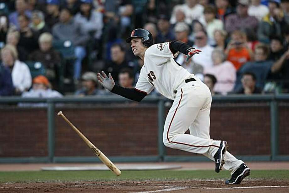Buster Posey runs down the first base line as the Giants square off against the Dodgers at AT&T Park on Sunday. Photo: John Sebastian Russo, The Chronicle