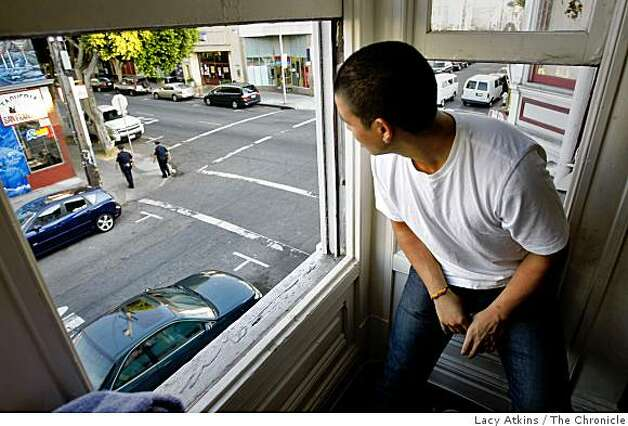 Benjamin Castaneda, 20 years old, looks outside a window from his home where he often sees norteno members hanging out, Wednesday  Oct. 22, 2008, in San Francisco, Calif. Photo: Lacy Atkins, The Chronicle
