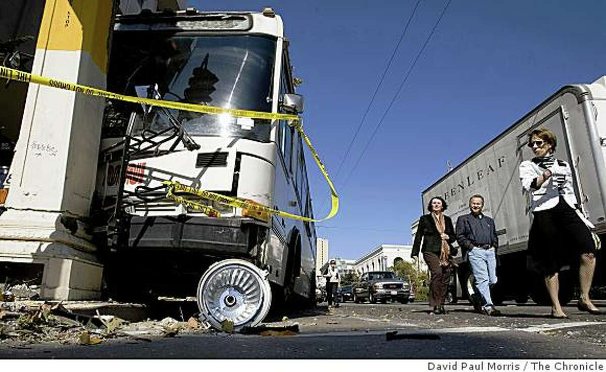 People walk past the MUNI bus 76X after it crashed driving southbound on Van Ness at Geary October 26, 2008 in San Francisco, California. A total of 6 people were taken to the hospital as a result of the accident. Photograph by David Paul Morris / The Chronicle