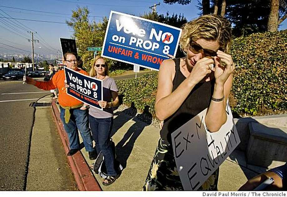Tara Walsh, 36 wipes a tear from her eye as she joins Proposition 8 opponents as they protest at the Morman Temple October 26, 2008 in Oakland, California.  Photograph By David Paul Morris / The Chronicle Photo: David Paul Morris, The Chronicle