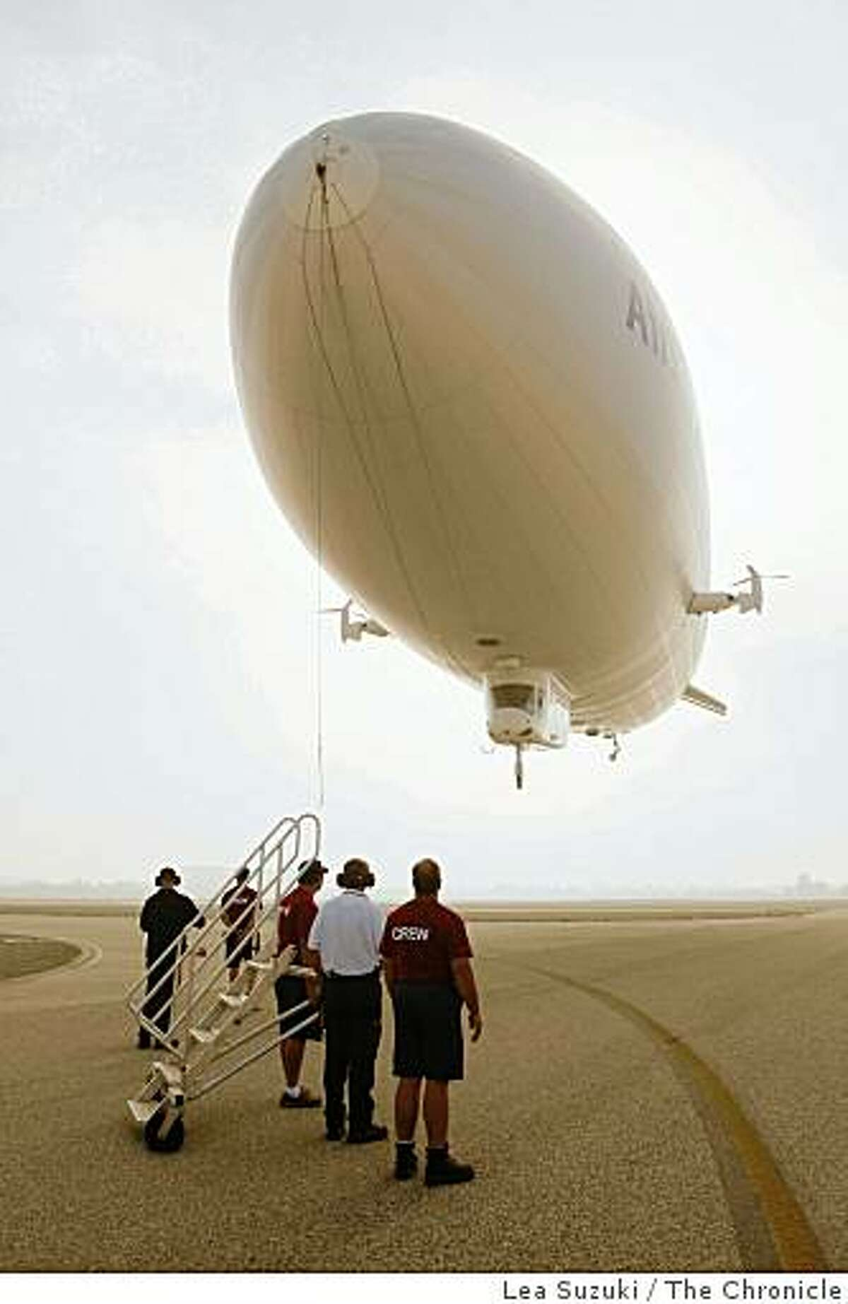 The ground crew prepares for the Zeppelin NT's landing at Moffet Field on Monday, October 27, 2008 in Mountain View, Calif.
