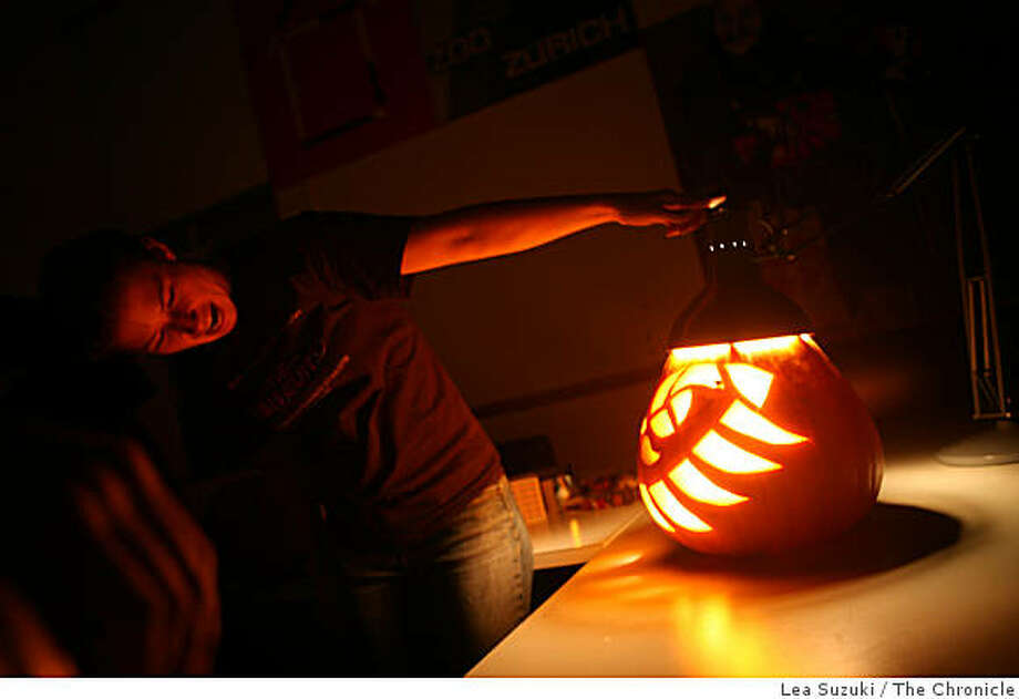 Karen Shakespear reacts to her pumpkin's design while testing it under a light during the Fundamental Visual Language class on Thursday, October 30, 2008  at Stanford University in Palo Alto, Calif. Photo: Lea Suzuki, The Chronicle