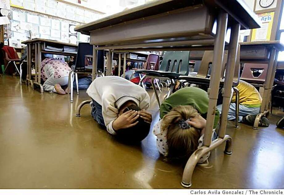 Lafayette Elementary School students practice emergency drills with Mayor Gavin Newsom in San Francisco, Calif., on Tuesday, October 21, 2008. They will drop, cover and hold on the 140th anniversary of a 6.8 earthquake on the Hayward Fault. Photo: Carlos Avila Gonzalez, The Chronicle