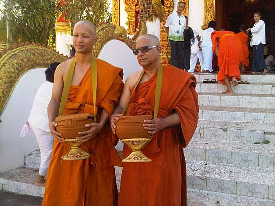 Deepak and Jate at the temple with begging bowls. Photo: Courtesy Deepak Chopra