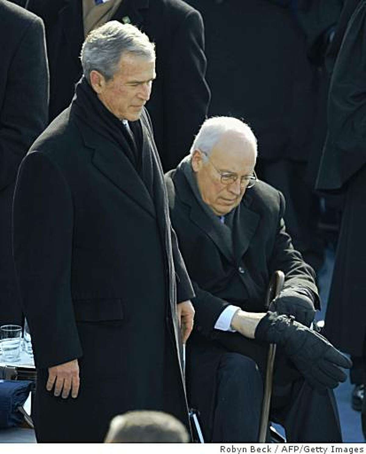 Outgoing US President George W. Bush stands beside a wheelchair-bound US Vice President Dick Cheney prior to the inauguration of Barack Obama.