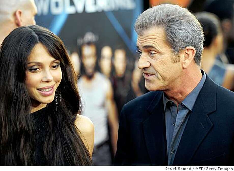 "Actor Mel Gibson (R) and his guest Oksana Grigorieva arrive for the Los Angeles industry screening of ""X-Men Origins-Wolverine"" at Grauman's Chinese Theater in Hollywood, California, on April 28, 2009. Photo: Jewel Samad, AFP/Getty Images"