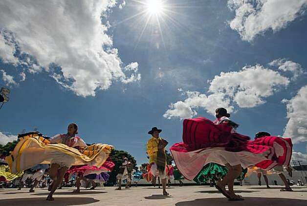 Dancers from Ixtepec city perform during the Guelaguetza celebration on July 27, 2009 in Oaxaca, Mexico. The Guelaguetza --which in Zapotec languaje means the act of participating in a community celebration-- is a festival held once a year which gathers music, dances, gastronomy and handicrafts of different ethnic groups and tribes of the state of Oaxaca. AFP PHOTO/Omar Torres (Photo credit should read OMAR TORRES/AFP/Getty Images) Photo: Omar Torres, AFP/Getty Images