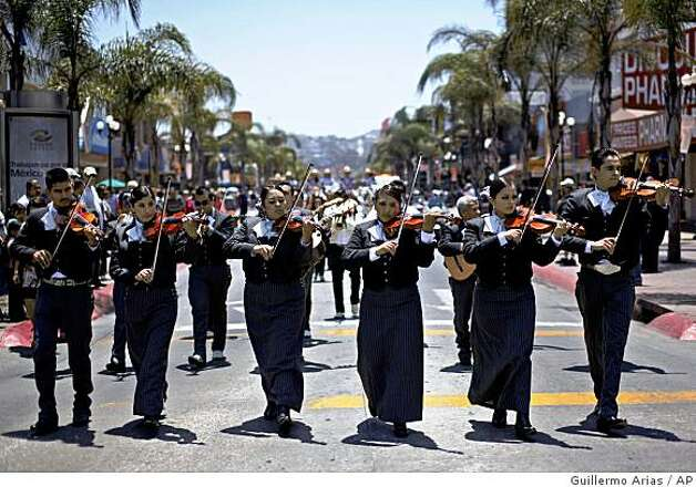 A mariachi band perform during a Mariachi festival at the Revolucion street in Tijuana, Mexico, Saturday, May 23, 2009. Photo: Guillermo Arias, AP