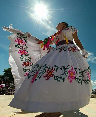 A dancer from San Pedro Ayutla performs during the Guelaguetza celebration on July 27, 2009 in Oaxaca, Mexico. The Guelaguetza is a festival held once a year which gathers music, dances, gastronomy and handicrafts of different ethnic groups and tribes of the state of Oaxaca. AFP PHOTO/Omar Torres (Photo credit should read OMAR TORRES/AFP/Getty Images) Photo: Omar Torres, AFP/Getty Images