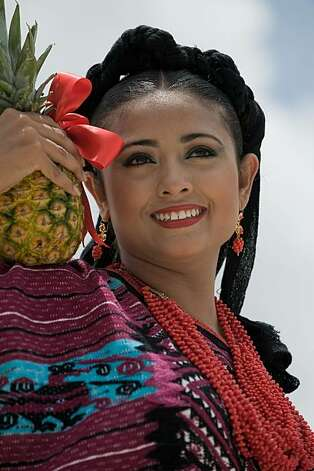 A dancer from Santa Maria Asuncion Tlaxiaco performs during the Guelaguetza celebration on July 27, 2009 in Oaxaca, Mexico. The Guelaguetza is a festival held once a year which gathers music, dances, gastronomy and handicrafts of different ethnic groups and tribes of the state of Oaxaca. AFP PHOTO/Omar Torres (Photo credit should read OMAR TORRES/AFP/Getty Images) Photo: Omar Torres, AFP/Getty Images