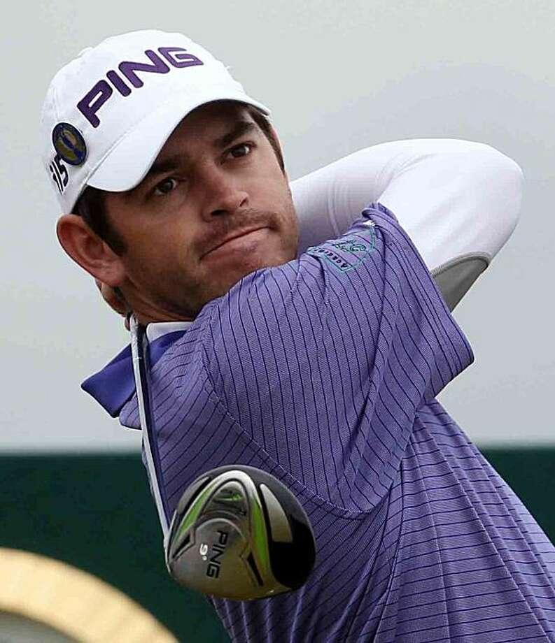South Africa's Louis Oosthuizen plays a shot from the 14th tee during the second round of the British Open Golf Championship on the Old Course at St. Andrews, Scotland, Friday, July 16, 2010. Photo: Alastair Grant, AP