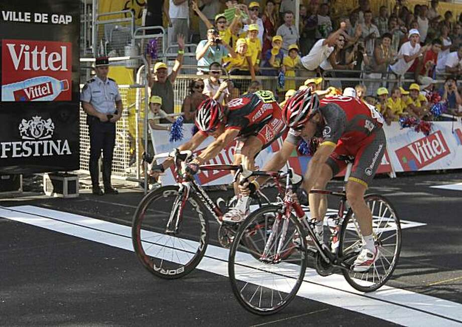 Sergio Paulinho of Portugal, right, pushes his wheel across the finish line  to win the 10th stage of the Tour de France cycling race over 179 kilometers (111.2 miles) with start in Chambery and finish in Gap, France, Wednesday, July 14, 2010, ahead of Vasil Kyryienka of Belarus, left. Photo: Peter Dejong, AP