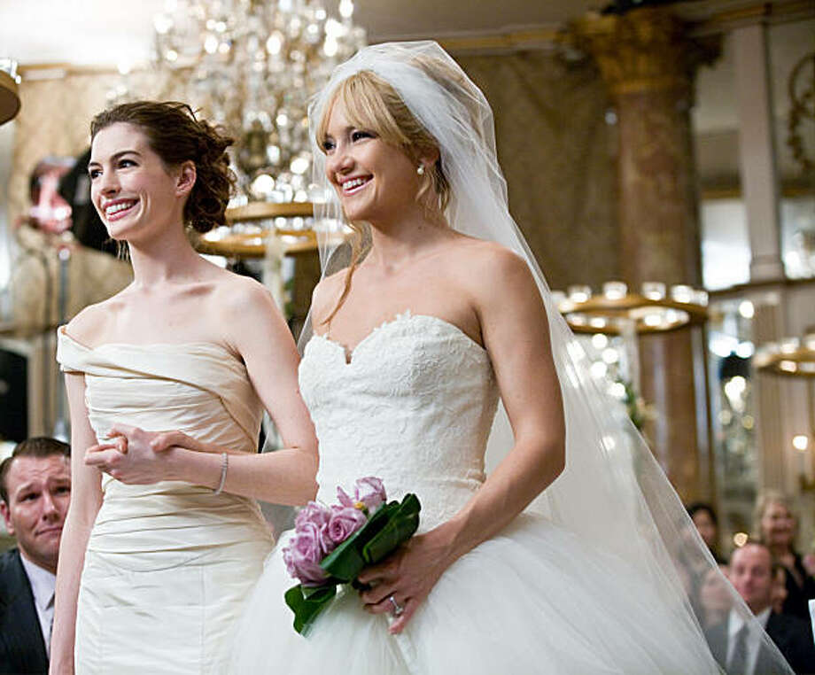 Battling brides Liv (Kate Hudson, left) and Emma (Anne Hathaway) have an emotional reunion at Liv's wedding. Photo: Claire Folger, Twentieth Century Fox