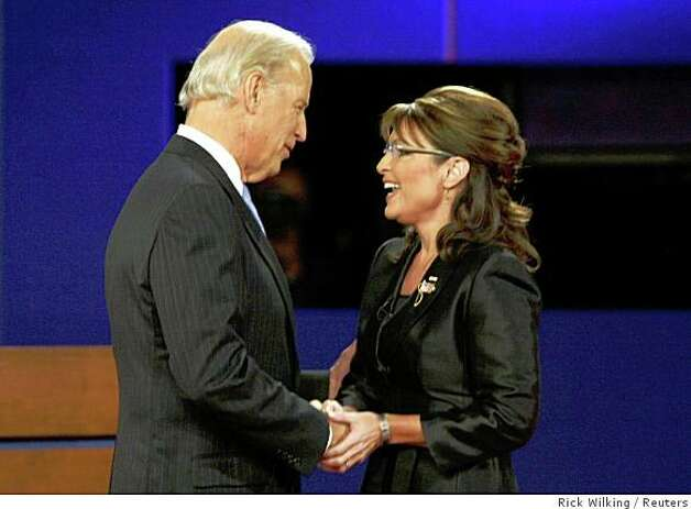 Democratic vice presidential nominee Senator Joe Biden (D-DE) greets Republican vice presidential nominee Alaska Governor Sarah Palin during the vice presidential debate at Washington University in St. Louis, Missouri October 2, 2008. Photo: Rick Wilking, Reuters